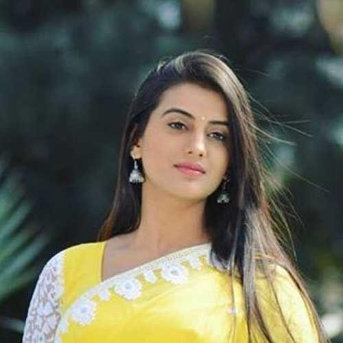 beautyfull indian looking girl in yellow sari