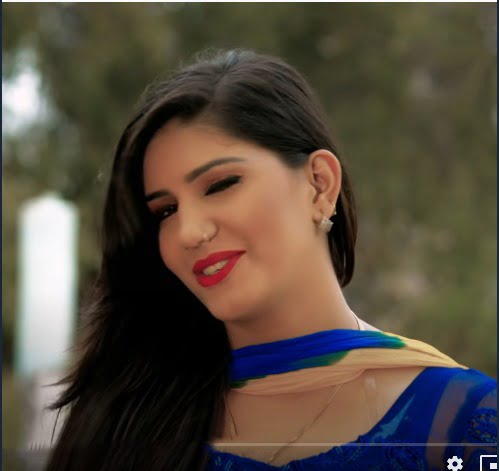 sapna chaudhary dance photo open hair and blue suite
